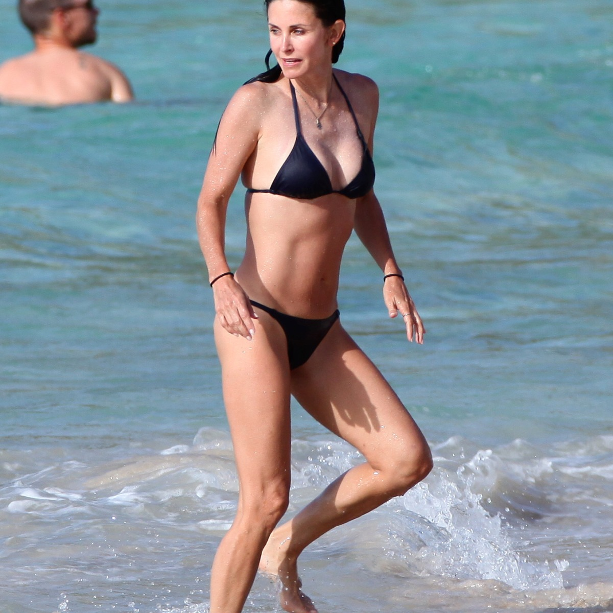eddbb4aa692 Reese Witherspoon Shows Off Her Diving Skills in a Cheeky Bathing Suit —  See the Video! - Closer Weekly