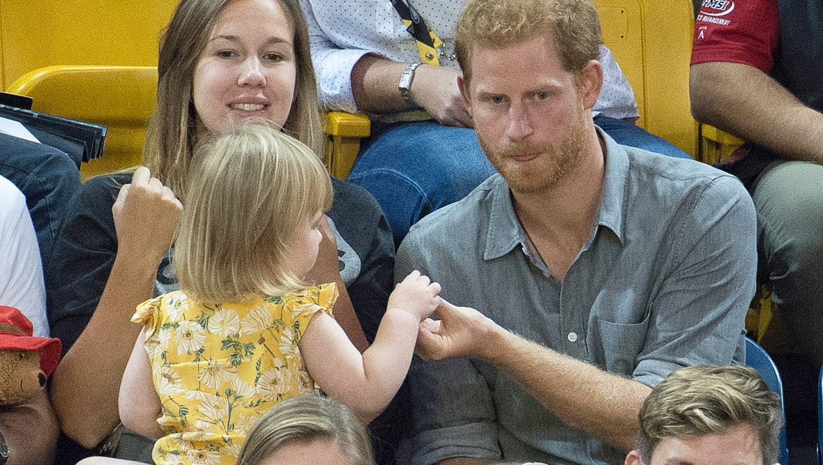 prince harry shares popcorn with emily henson splash news