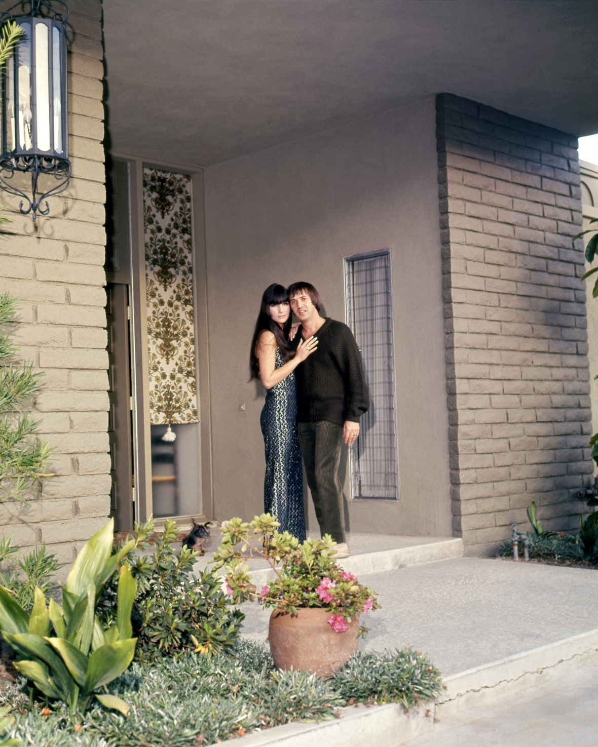 cher and sonny out side of their encino, calif home getty images