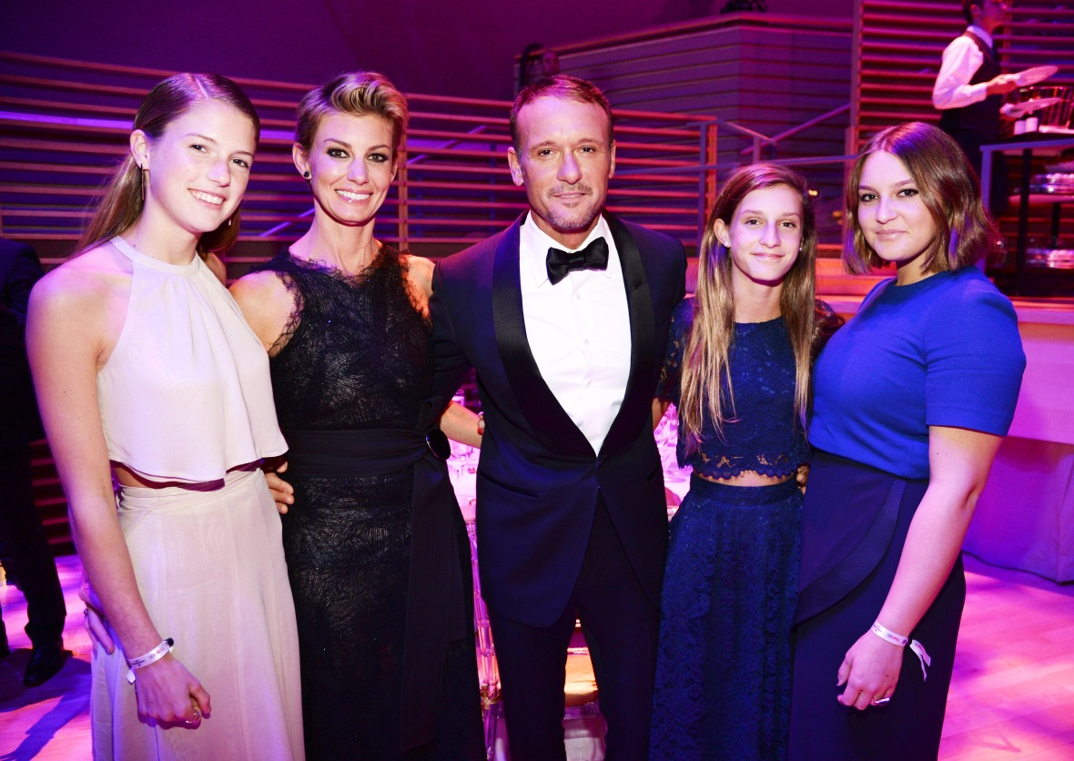 faith, tim and their daughters in april 2015. (photo credit: getty images)