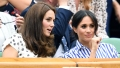 Meghan Markle Kate Middleton talking in stands at game