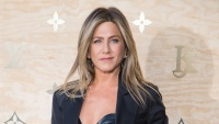 jennifer-aniston-leather-top-black-blazer-black-pants-louis-vuitton