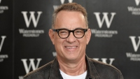 tom-hanks-black-jean-jacket-white-shirt-book-photo-signing