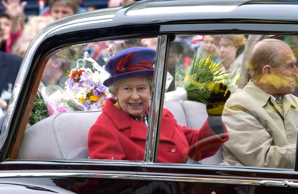 Queen Elizabeth In Car Waving