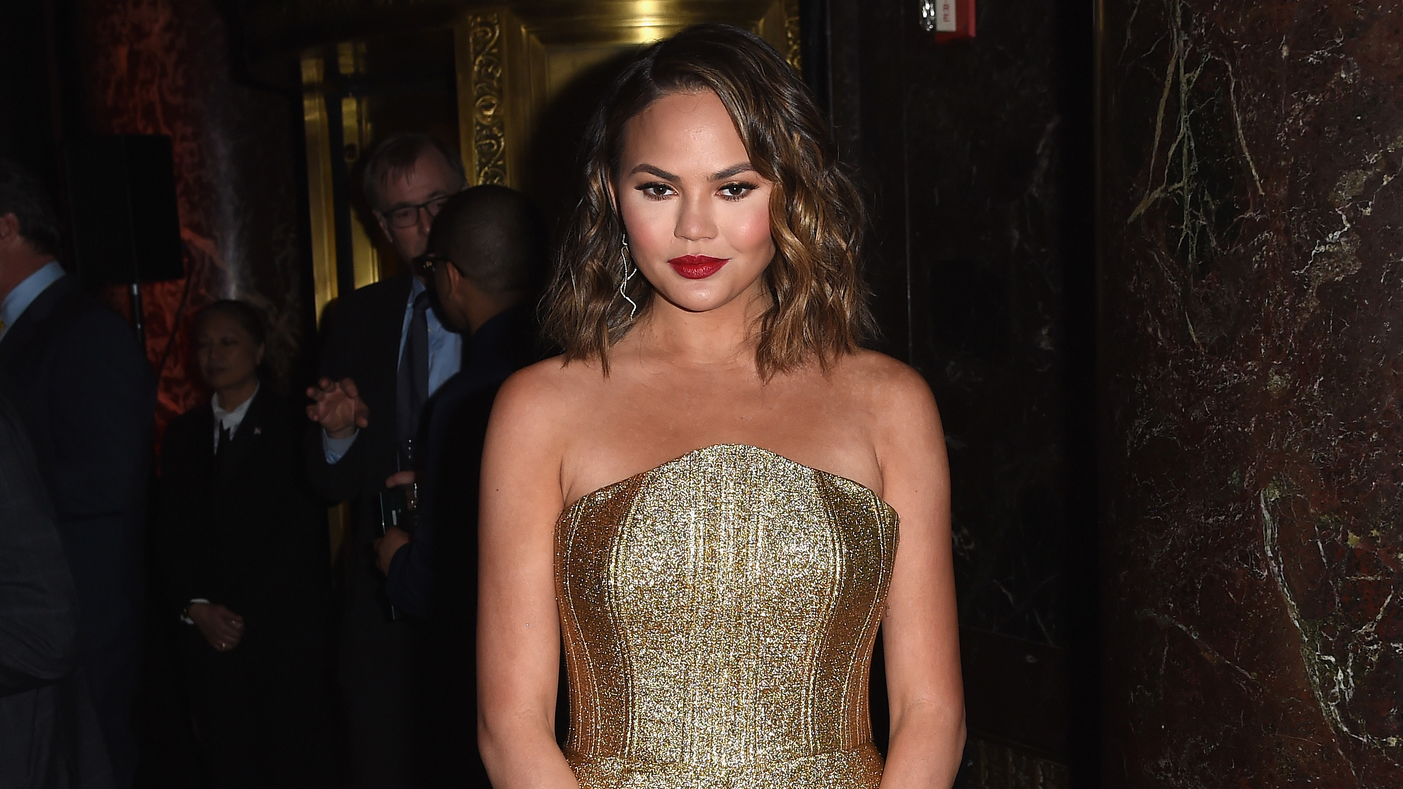 6e06bd236d06b Chrissy Teigen Slams Baby Bump Speculation in the Most Elegant Way: 'Think  Twice'
