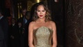chrissy-teigen-gold-dress-city-harvest-2017.