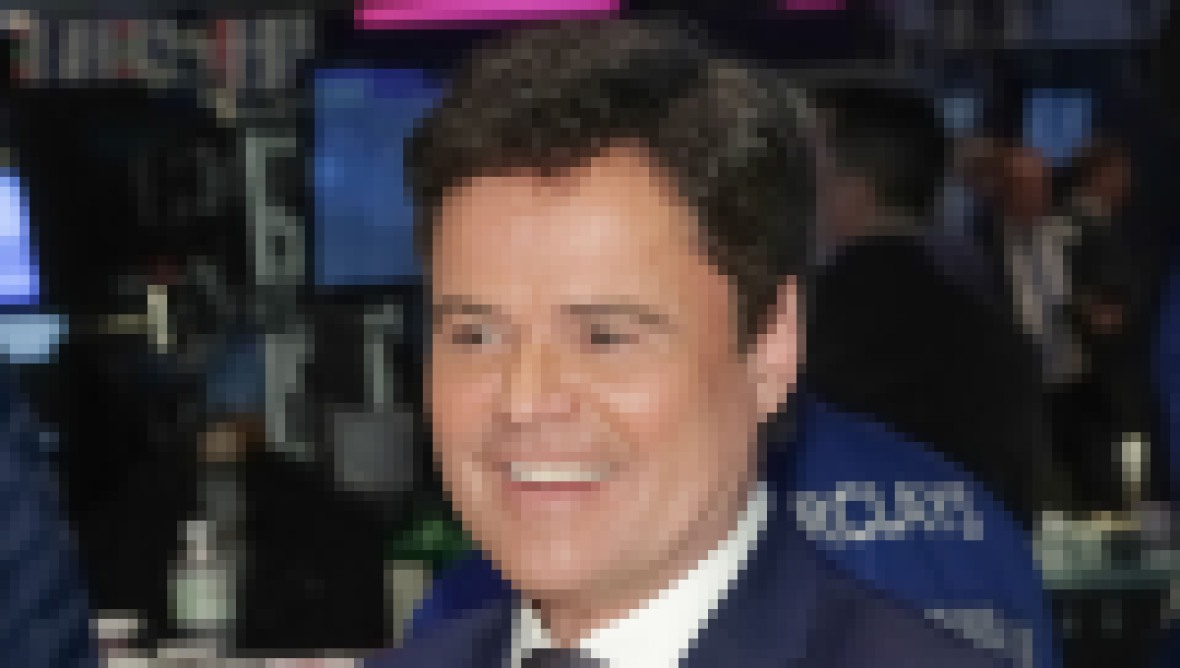 donny-osmond-rings-nyse-closing-bell-2015