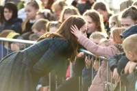 Britain's Catherine, Duchess of Cambridge reacts as a young girl touches her hair whilst she greets wellwishers outside of a community centre in Dundee, eastern Scotland,