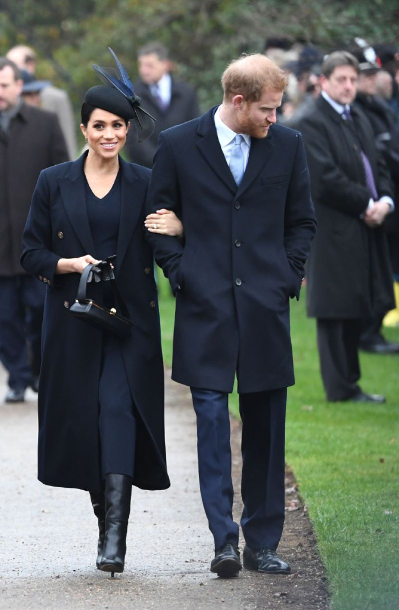 Meghan, Duchess of Sussex and Britain's Prince Harry, Duke of Sussex arrive for the Royal Family's traditional Christmas Day service at St Mary Magdalene Church in Sandringham,