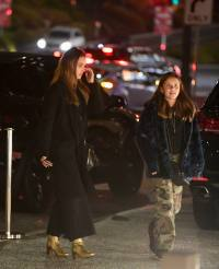 Jessica Alba braves the rain to take her daughters to a movie