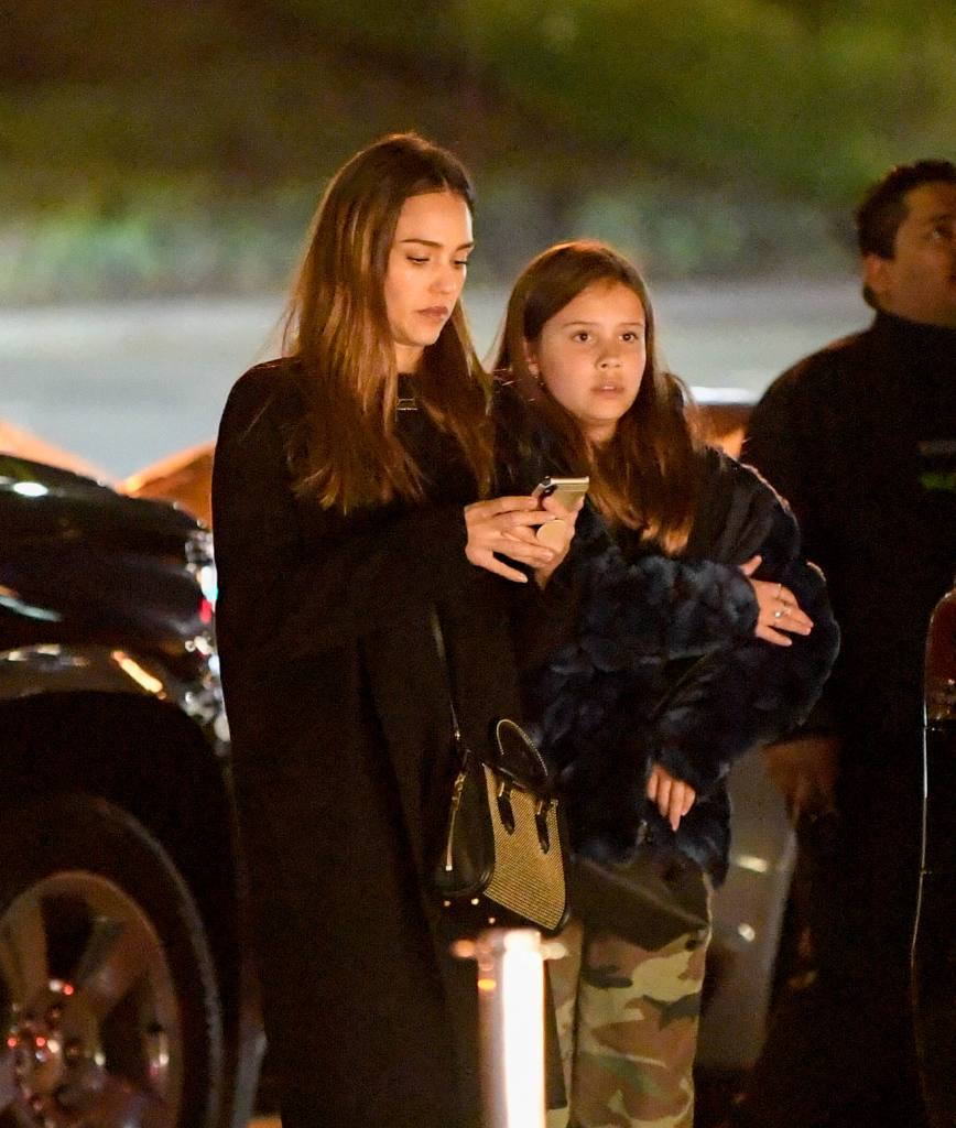 EXCLUSIVE: Jessica Alba braves the rain to take her daughters to a movie