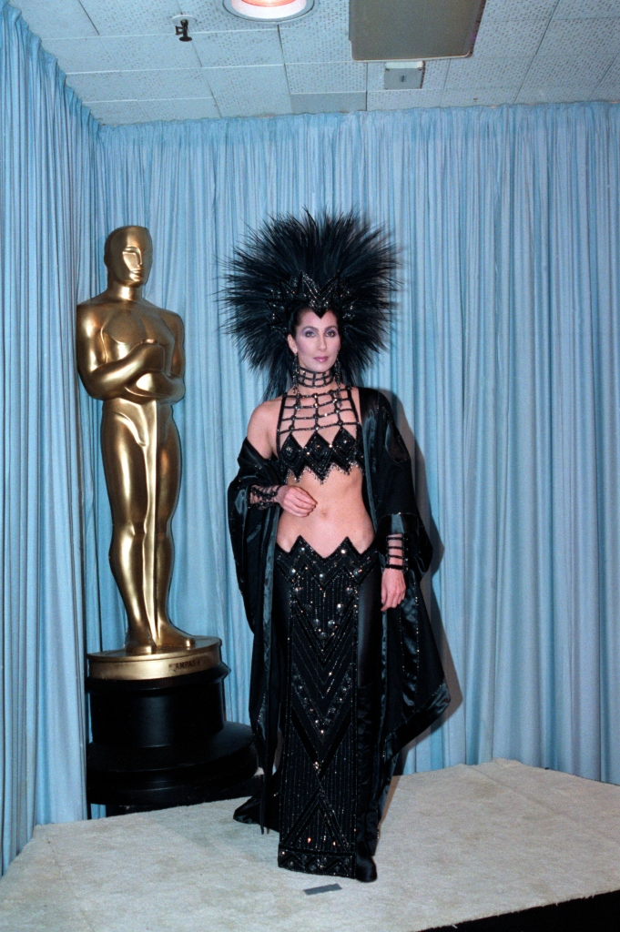 Cher is shown in a full-length photo from backstage at the Academy Awards