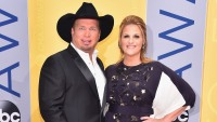 Singer-songwriters Garth Brooks and Trisha Yearwood attend the 50th annual CMA Awards