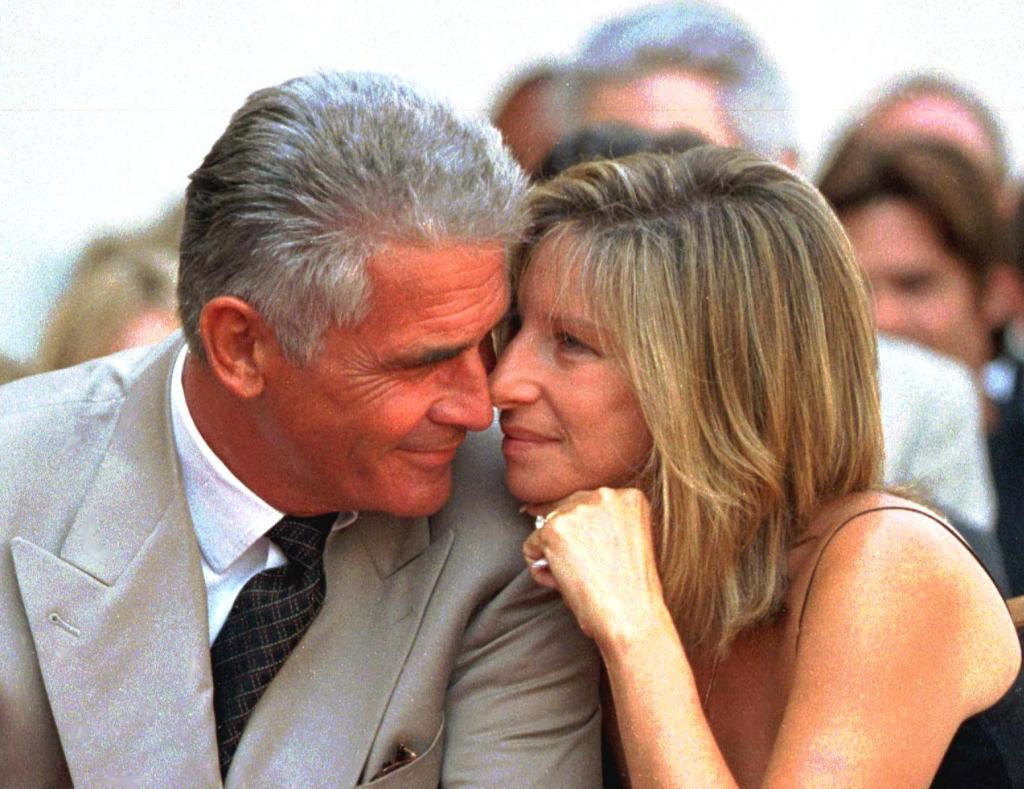 US actor James Brolin and his singer-actress wife Barbra Streisand share a tender moment during the Hollywood Walk of Fame