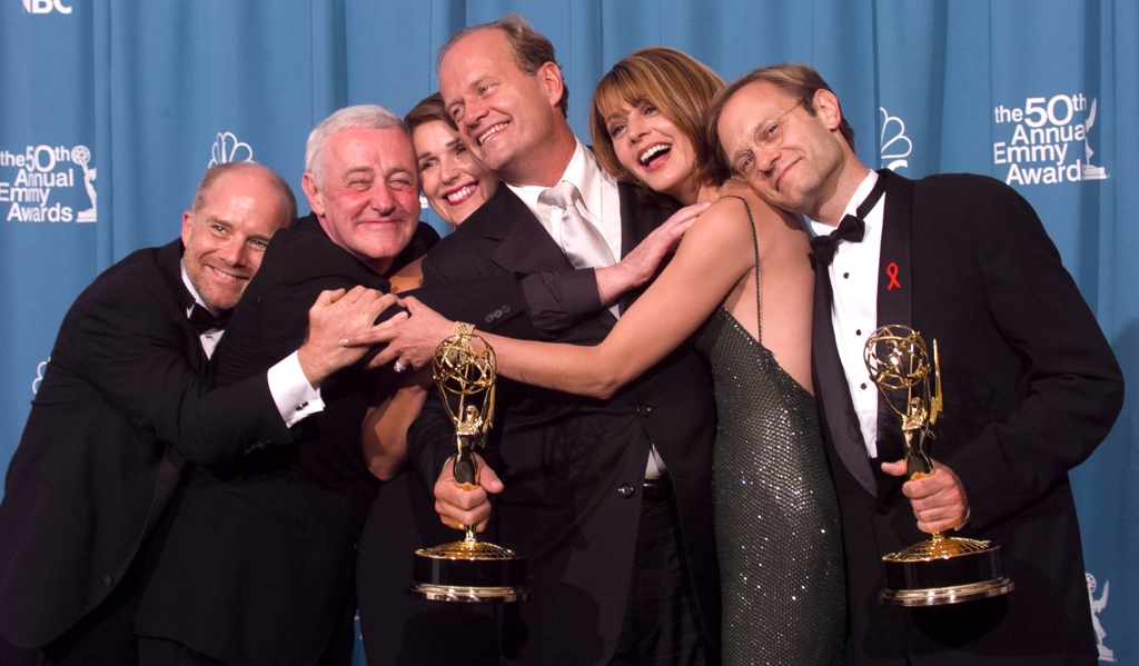 Emmy-winners, Actors Kelsey Grammer (center) and David Hyde Pierce (R) are joined by fellow 'Frasier' cast members actors Jane Leeves (2nd R), Peri Gilpin, John Mahoney (2nd L) and James Burrows (L) for a group-hug backstage
