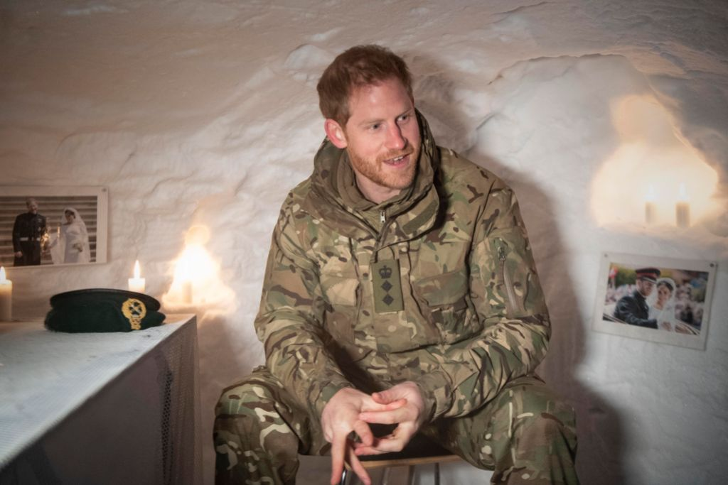 Prince Harry, Duke of Sussex in a Quincey Shelter, a makeshift shelter built of snow, during a visit to Exercise Clockwork