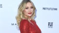 Kate Hudson wearing a red, sparkly dress.