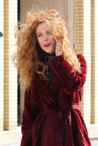 Nicole Kidman sports curly red hair and is seen on the phone while filming the HBO drama series THE UNDOING in New York City.