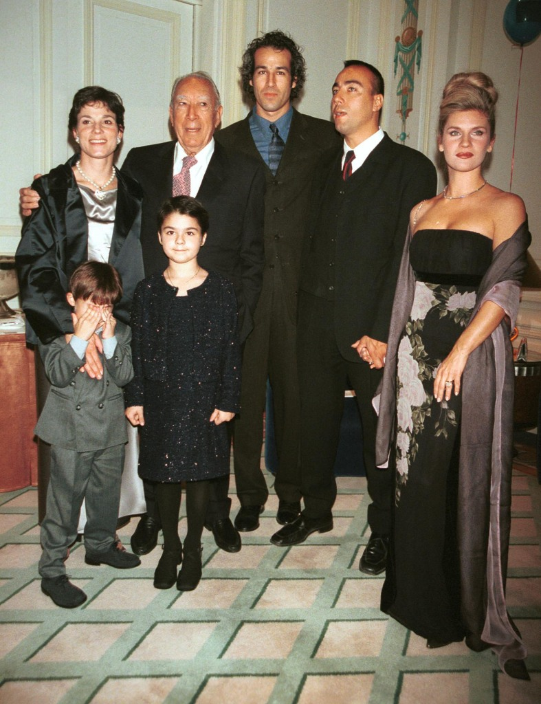 Anthony Quinn, second from left in back row, along with his family, wife Kathy Quinn, left, son Jeb, third from left, son Lorenzo, fourth from left and Lorenzo's wife, Giovanna, youngest son, Ryan and daughter Antonia pose for a portrait during a roast party for Anthony Quinn October 19, 2000 at the Palace Hotel in New York City.