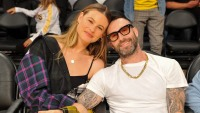 Adam Levine and Behati Prinsloo attend a basketball game between the Los Angeles Lakers and the Houston Rockets at Staples Center