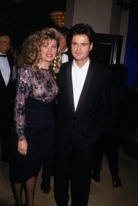 American singer and actor Donny Osmond and wife, Debbie, attend a formal event together, 1980s.