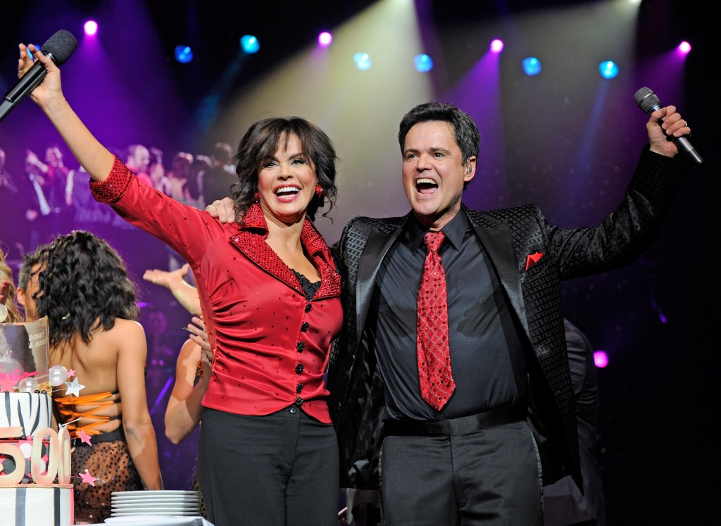 Singers Marie Osmond and Donny Osmond celebrate after being presented a cake at the conclusion of their 500th Donnie and Marie variety show at the Flamingo Las Vegas