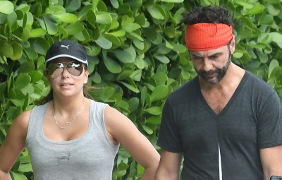 Eva Longoria and husband Jose Baston take a walk along the beach in Miami.
