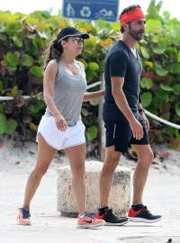 Eva Longoria and husband Jose Baston take a walk along the beach in Miami.
