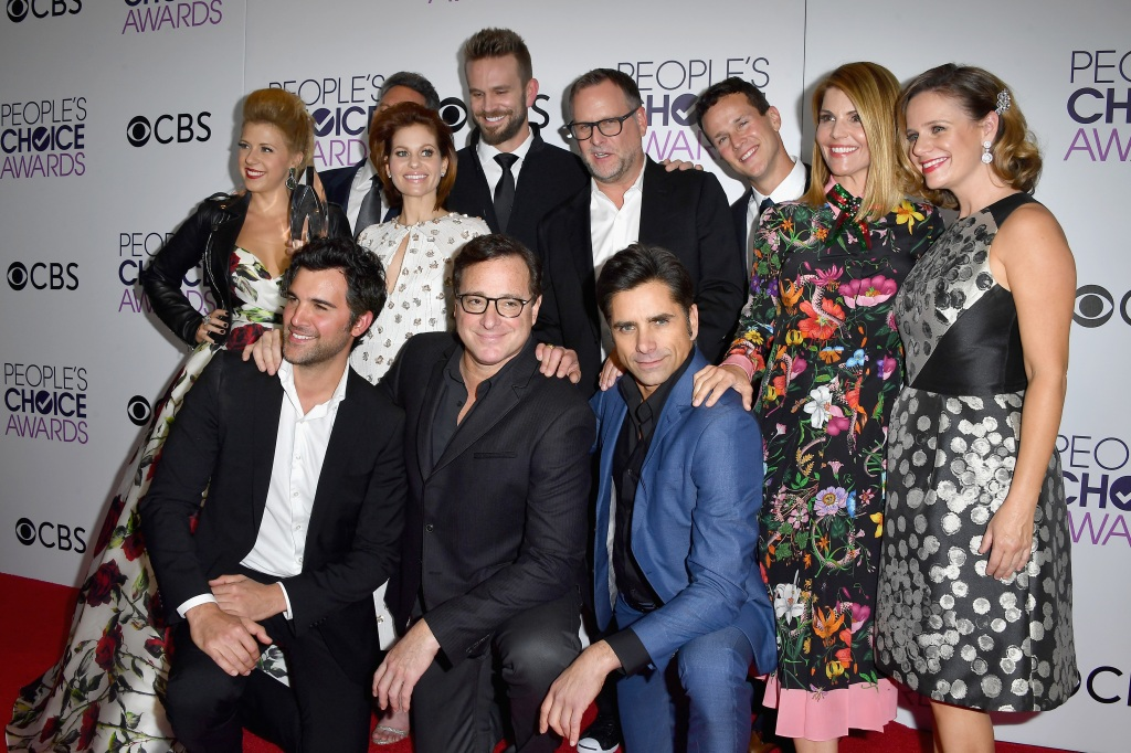 Actress Jodie Sweetin, producer Jeff Franklin, actors Candace Cameron Bure, John Brotherton, Dave Coulier, Scott Weinger, Lori Loughlin, Andrea Barber and (front L-R) actors Juan Pablo Di Pace, Bob Saget and John Stamos, winners of the Favorite Premium Comedy Series Award, 'Fuller House' pose in the press room during the People's Choice Awards 2017