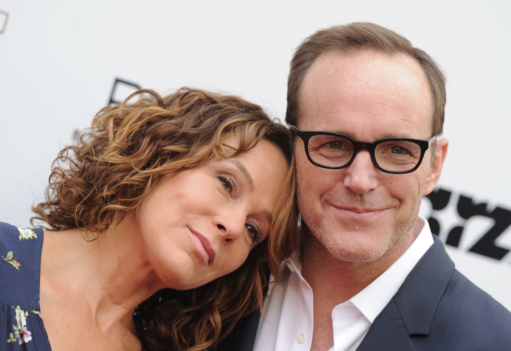 Actress Jennifer Grey (L) and actor/director Clark Gregg arrive at the Los Angeles premiere of 'Trust Me'
