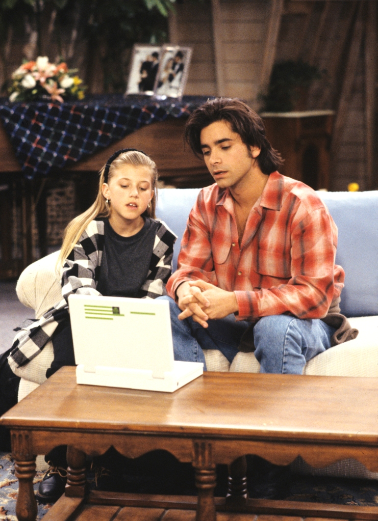 "UNITED STATES - FEBRUARY 09: FULL HOUSE - ""The Heartbreak Kid"" - Season Six - 2/9/93, Jesse (John Stamos) was assisted by Stephanie (Jodie Sweetin) with his laptop computer., (Photo by ABC Photo Archives/ABC via Getty Images)"