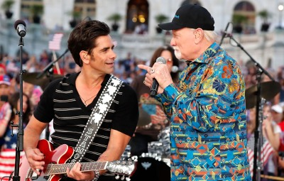 Emmy nominated actor John Stamos (L) performs with Mike Love of The Beach Boys at A Capitol Fourth at U.S. Capitol