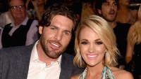 NHL player Mike Fisher (L) and musician Carrie Underwood attend the 2016 CMT Music awards