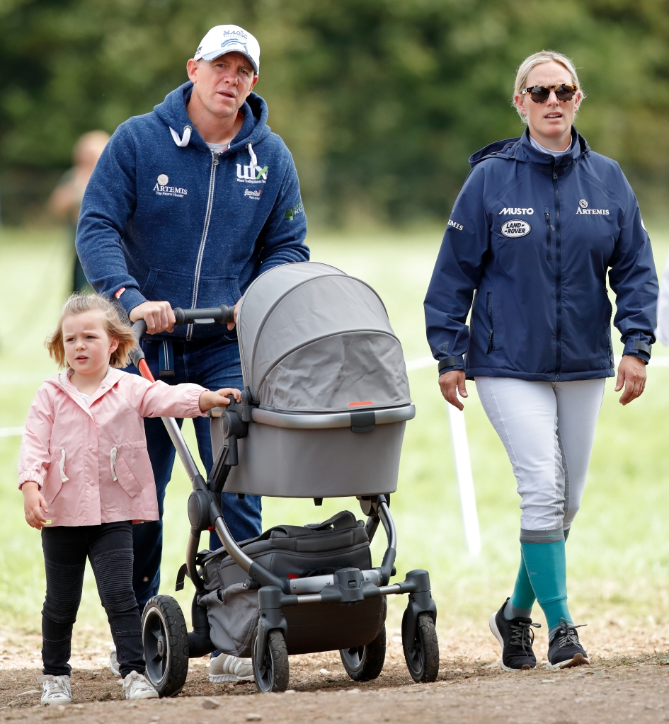 Mike Tindall and Zara Tindall with their daughters Mia Tindall and Lena Tindall (in her pram) attend day 3 of the Whatley Manor Horse Trials at Gatcombe Park