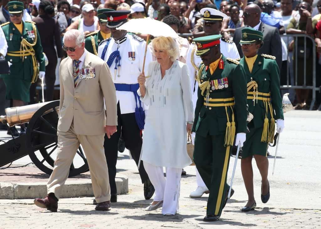 Prince Charles, Prince of Wales and Camilla, Duchess of Cornwall attend a parade and wreath laying ceremony at Hereos Square on March 19, 2019 in Bridgetown, Barbados