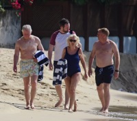 Prince Charles and wife Camilla, Duchess of Cornwall, pictured on the beach in Barbados. The Prince of Wales, 70, showed off his trim frame in floral trunks while Camilla, 71, wore an aqua-blue one-piece swimsuit. Camilla and Charles are touring the Caribbean representing the Queen at the behest of the Foreign Office.
