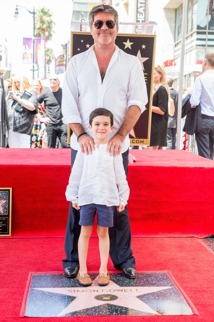 Simon Cowell and Eric Cowell attend a ceremony honoring Cowell with a star on the Hollywood Walk of Fame