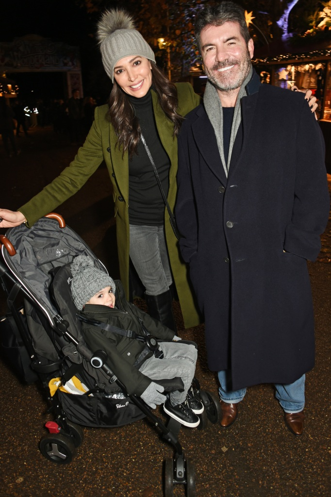 Simon Cowell (R) with Lauren Silverman and son Eric Cowell attend a VIP Preview of Hyde Park's Winter