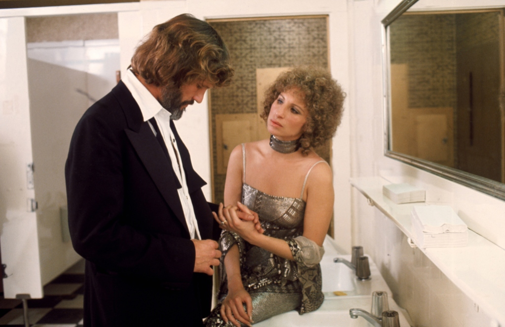 "Kris Kristofferson and Barbra Streisand on the set of ""A Star is Born"""