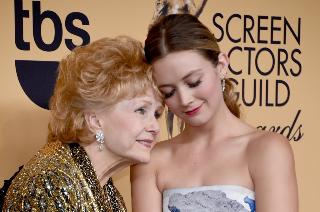 Actress Debbie Reynolds (L), recipient of the Screen Actors Guild Life Achievement Award, and Billie Lourd pose in the press room at the 21st Annual Screen Actors Guild Awards at The Shrine Auditorium