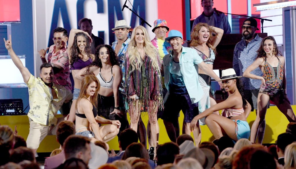 Carrie Underwood (C) performs onstage during the 54th Academy Of Country Music Awards