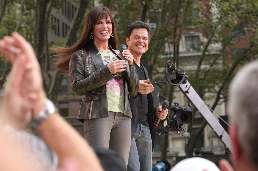 "Actors and singers Marie Osmond and Donny Osmond perform on ABC's ""Good Morning America"" at Bryant Park"