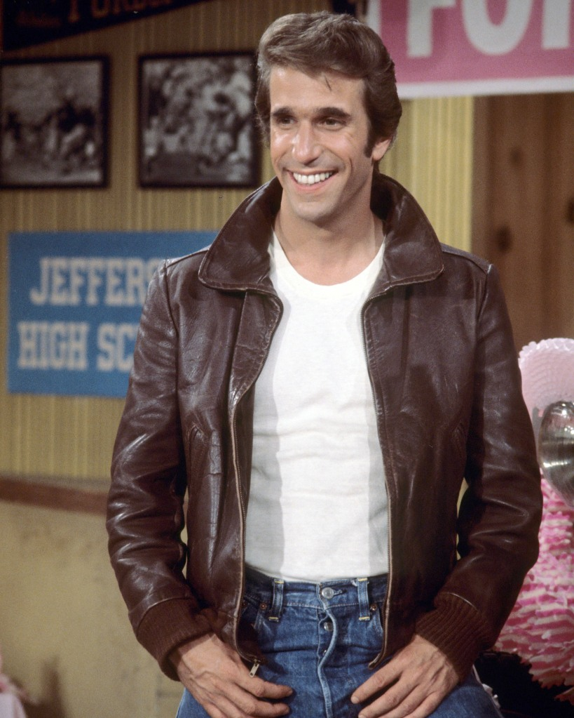 Henry Winkler, US actor, wearing a brown leather jacket and white t-shirt in a publicity still issued for the US television series, 'Happy Days', USA, circa 1977. The sitcom starred Winkler as 'Arthur Fonzarelli',