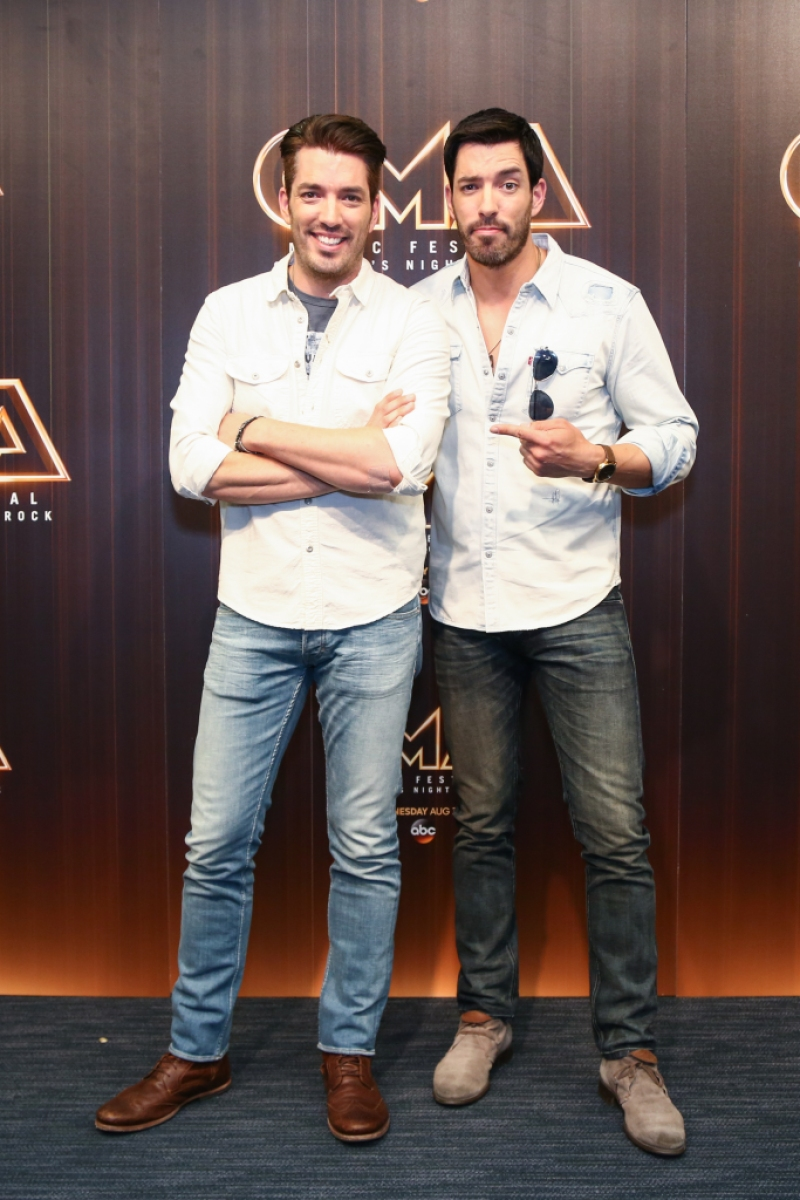 Jonathan Scott and Drew Scott in the press room during day 2 of the 2016 CMA Music Fest