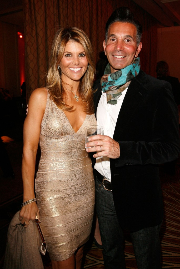 Actress Lori Loughlin (L) and husband Mossimo Giannulli attend the Saks Fifth Avenue's Unforgettable Evening cocktail reception