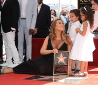 Mariah Carey and children Moroccan Scott Cannon and Monroe Cannon attend Carey's induction into the Hollywood Walk of Fame