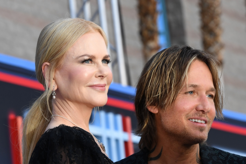 Australian singer Keith Urban (R) and his wife Australian actress Nicole Kidman arrive for the 54th Academy of Country Music Awards
