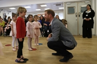 Britain's Prince Harry, Duke of Sussex (C) chats with children taking part in ballet class for 4 to 6 year olds, during a visit to YMCA South Ealing