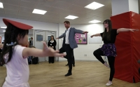 Britain's Prince Harry (R), Duke of Sussex (R) takes part in a ballet class for 4 to 6 year olds, while on a visit to YMCA South Ealing, during a visit to YMCA South Ealing