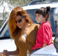 eva-mendes-makes-rare-appearance-in-los-angeles-with-her-and-ryan-goslings-two-daughters